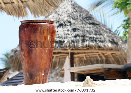 Pot on Nungwi white-sand beach, Zanzibar - stock photo