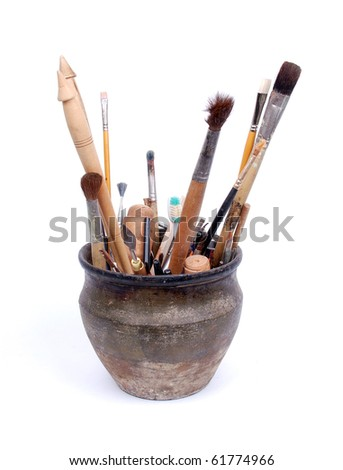pot with brushes - stock photo