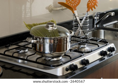 pot with spaghetti on kitchen surface
