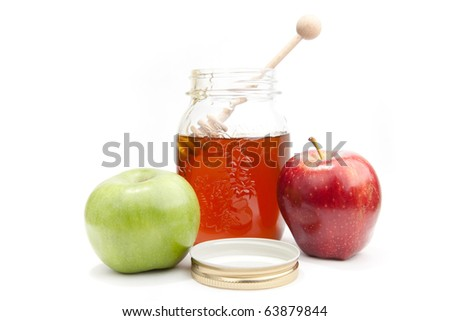 Pot with the fresh honey and tow apples on the white background