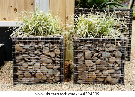 pot with wire mesh and stone pattern - stock photo