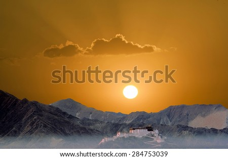 potala in Lhasa in sunset with mountains - stock photo