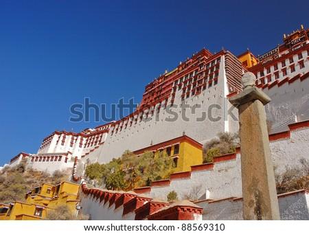 Potala palace and graceful stone pillar - stock photo
