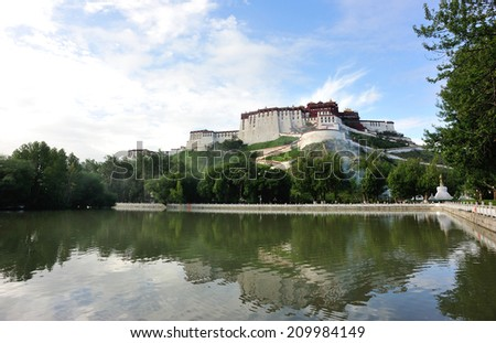 potala palace lake,tibet ,china - stock photo