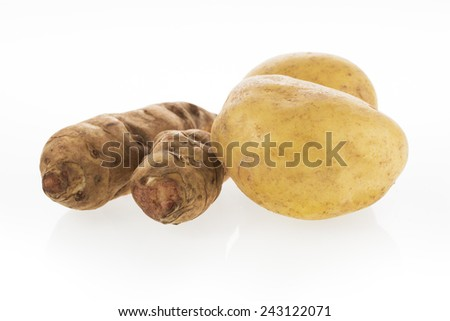 Potato and Jerusalem Artichokes isolated on white - stock photo