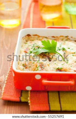 potato and kohlrabi gratin with cheese - stock photo