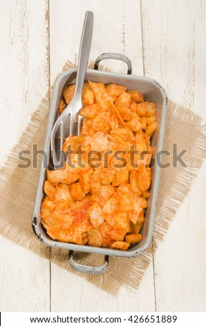 potato and pasta with sunflower oil and paprika powder, hungarian meal in a baking tin - stock photo