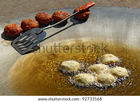 potato ball deep fry in oil on the pan - stock photo