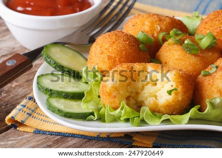 Potato balls fried on a plate close-up. horizontal  - stock photo