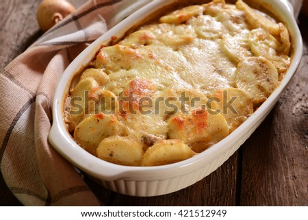 Potato casserole with meat and mushrooms - stock photo