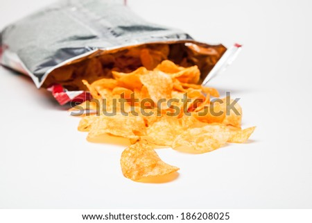 Potato chips and bag on white - stock photo