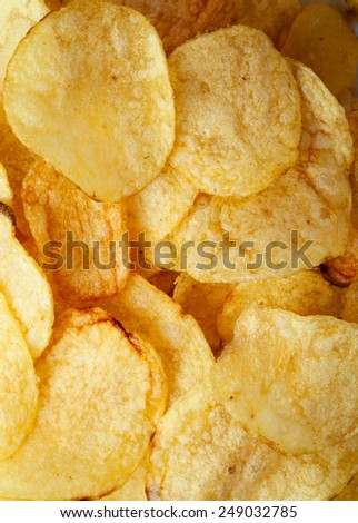 Potato chips background close-up - stock photo