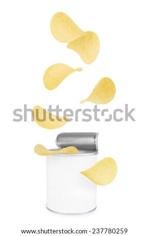 Potato chips falling in a tin - stock photo