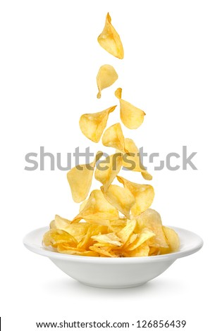 Potato chips falling in the plate. Isolated on white background - stock photo
