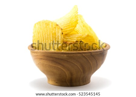 Potato chips in a small wooden bowl on white background