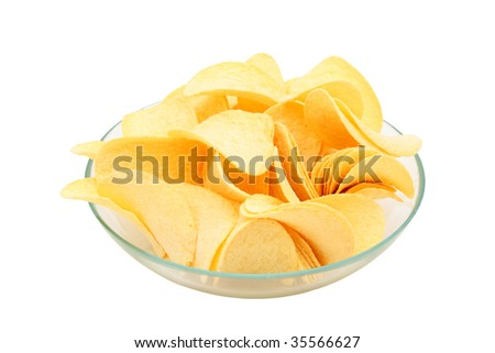 Potato chips in a transparent bowl is isolated on white. - stock photo