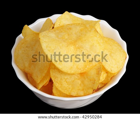 Potato chips in a white cup on a black background, isolated