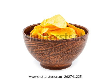 Potato chips in a wooden bowl isolated on white background. - stock photo