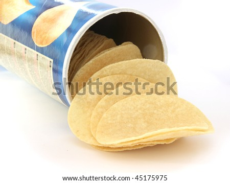 Potato chips on white background in a can - stock photo
