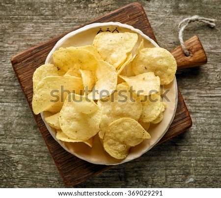 potato chips on wooden table, top view - stock photo