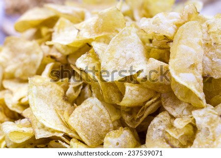 Potato chips -  predominant part of the snack food market in Western countries - stock photo