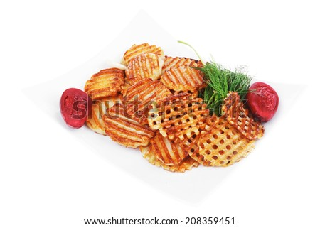 potato chips served on white plate with small pickled eggplants isolated over white background - stock photo