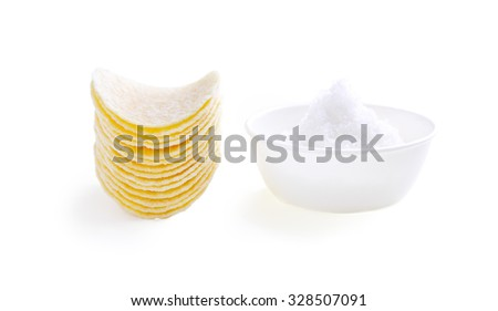 Potato Chips with Cup of Salt on White Background - stock photo