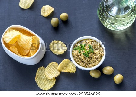 Potato chips with olive pate - stock photo