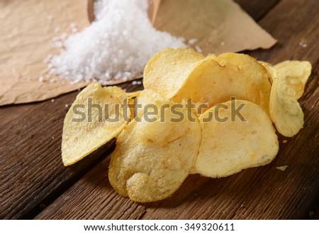 Potato chips with sea salt - stock photo