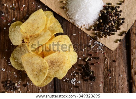 Potato chips with sea salt and pepper - stock photo