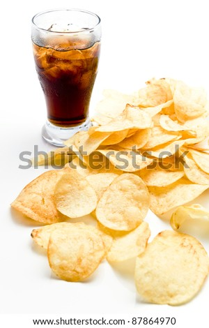 Potato chips with soda on white background - stock photo