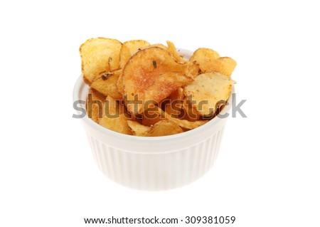 Potato crisps in a ramekin isolated against white - stock photo