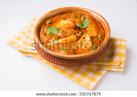 potato curry or aalu masala or aaloo masala with green peas, indian food, main course, spicy - stock photo