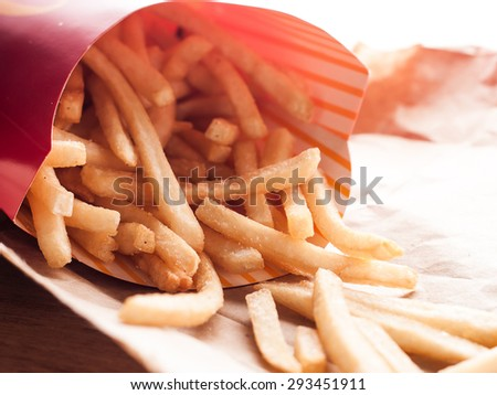 potato french fries with salt on paper