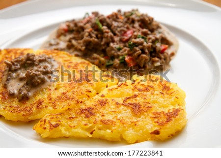 potato fritter with minced meat sauce