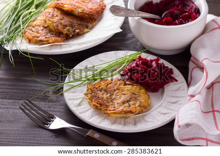 Potato fritters on a wooden surface - stock photo