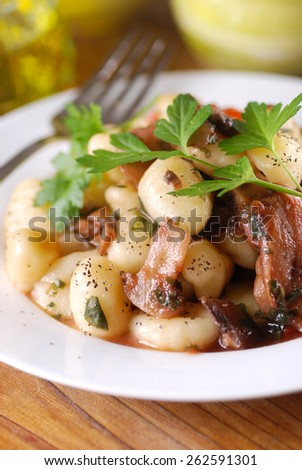 potato gnocchi with mushrooms and parsley