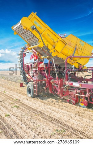 potato harvester in work close up view agricultural concept  - stock photo