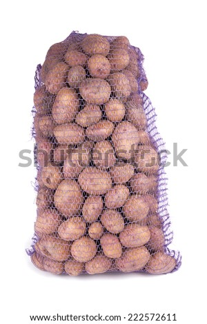 Potato in bag isolated on a white background  - stock photo