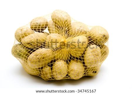 Potato in the net - stock photo