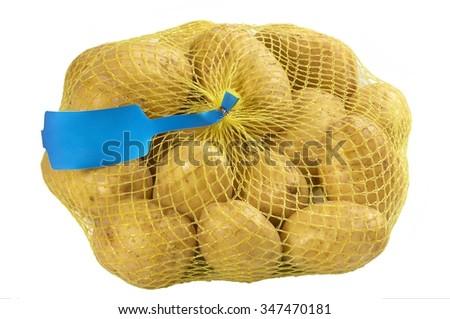 potato in yellow Plastic Mesh Sack on White Background - stock photo