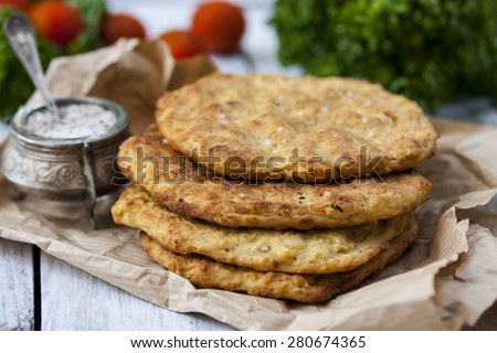 Potato Pancake with parsley on a wooden table  - stock photo