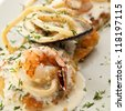 Potato Pancake with Seafood and Cream Sauce - stock photo