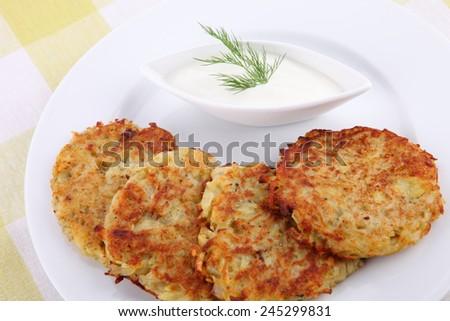 Potato Pancake with Sour Cream - stock photo