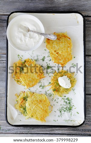 potato pancake with sour cream, food top view - stock photo