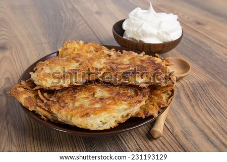 potato pancakes - draniki - with sour cream - the national dish of Ukrainian and Belarusian cuisine