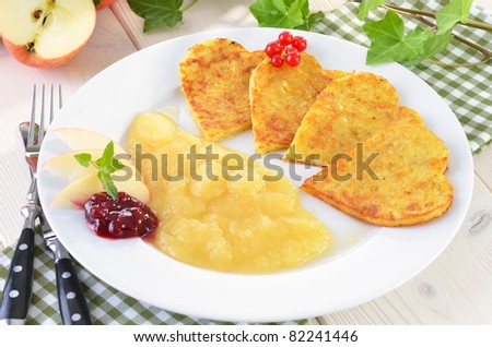 Potato pancakes in the shape of a heart - stock photo