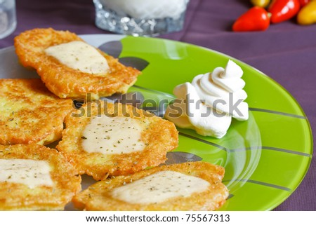 potato pancakes with cheese and sour cream