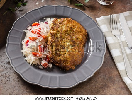 Potato pancakes with coleslaw, place for your advertising