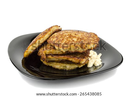 potato pancakes with sauce on plates - stock photo